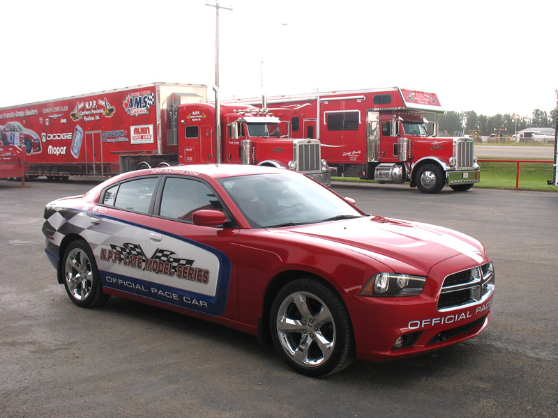 NPP LATE MODEL SERIES PACE CAR IN FRONT OF TEAM NPP HAULERS